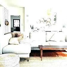 charcoal grey couch decorating living room medallion rug aqua white high gloss finish fiberglass coffee table