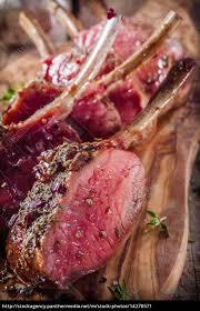 Stock Photo 14278571 Rare Seasoned Lamb Chops On Wooden Cutting Board
