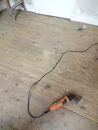 sanding floorboards by hand