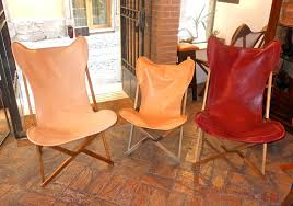 tripolina folding chair in leather and teak big and small
