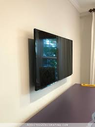 how to build an easy DIY frame for a wall mounted flat screen tv - 15