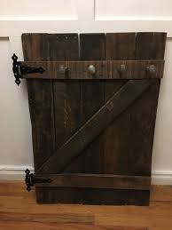 How To Make A Coat Rack With Railroad Spikes Reclaimed Barn DoorCoat RackRailroad SpikesRailroad Coat 80