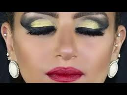 heavy makeup thick winged liner gold shadow by amina saad