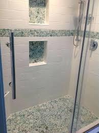 pebble tile shower floor stunning shower floor border and niches using sliced sea green pebble tile