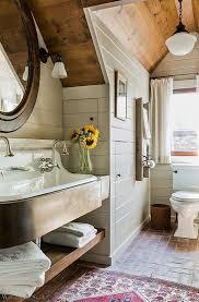 simple fresh rustic bathroom with brick floor shiplap walls farm sink and wood ceiling