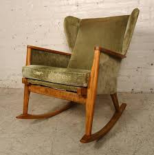 this unique rocker designed by parker knoll features a cushioned seat light wood frame and