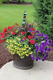 beautiful planter with red purple and orange flowers