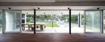 sliding glass doors fully open up the lower level to the lovely landscape outside