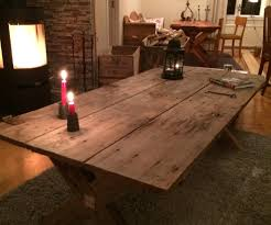 table made out of a 100 year old door 4 steps with pictures