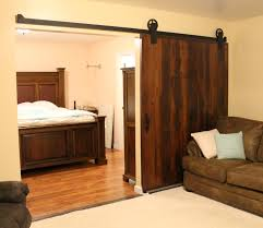 awesome barn door trolley hardware residential sliding lincdor l c reclaimed shown with wagon wheel pendant light track roller iron unistrut