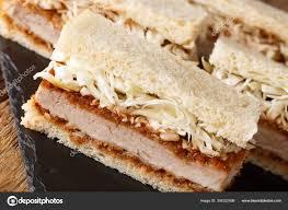 Japanese Katsu Sando sandwiches with tonkatsu sauce and cabbage — Stock  Photo © lenyvavsha #304322498