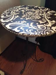 Cover old tables with fabric and use mod podge to seal. With all the moving