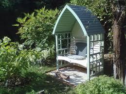 wooden covered garden seat with hard standing and footrest