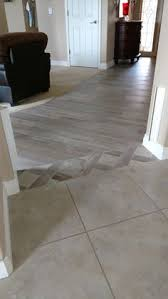 wood floor to tile transition ideas