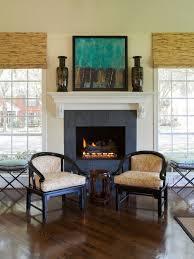 elegant dark wood floor family room photo in houston with beige walls a standard fireplace