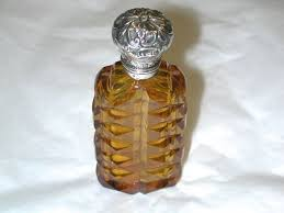 antique victorian amber coloured scent bottle with silver top
