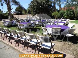 white plastic chairs with round table with white table cloth and purple overlay diamond