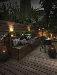 outdoor backyard lighting ideas. upscale outdoor seating bench lit by candles backyard lighting ideas e