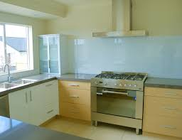 astonishing soft blue glass backsplash and corner kitchen cabinet with wall mount range hook over modern chrome kitchen stove in minimalist kitchen decors