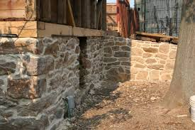 existing stone foundation of the barn was re pointed with an appropriate lime mortar at all exposed surfaces