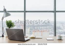 work tables office. workplace with notebook laptop comfortable work table in office windows and city view tables