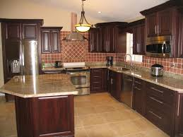 Oak Cabinet Kitchen Backsplash Pictures With Oak Cabinets And Uba Tuba Granite Rafael