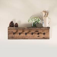 Reclaimed Wood Coat Rack Shelf DESCRIPTION This rustic wall rack is handmade with reclaimed 27