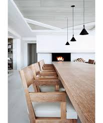 inside liargre s home minimal interior with white walls black ls natural wood table chairs
