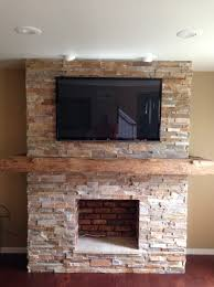 reclaimed wood mantels stone veneer fireplace