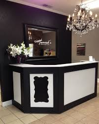 front desk stenciled black wall using the marrakech trellis stencil from cutting edge stencils