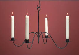 staggering wax candle chandelier lighting photo concept
