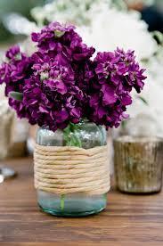 Blue Mason Jars Wedding Decor purple flowers in blue mason jar wedding centerpieces Deer Pearl 42