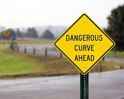 windy road sign blind corner sign