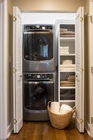 a maytag washer and dryer is stacked in this organized closet with folding louvered doors talianko design group closet laundry room