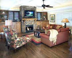 stone fireplace mantel shelf living room traditional with ceiling fan lighting above mounting tv height wall