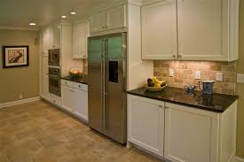 kitchen backsplashes with white cabinets recessed lighting and drum pendant l shape cabinet dark granite top