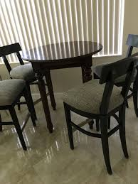 used real wood round table with 4 high chairs swivel general in hollywood fl offerup