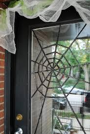 halloween front door decorationsDIY Halloween Front Door Decoration Subtle Spiderwebs  Merriment