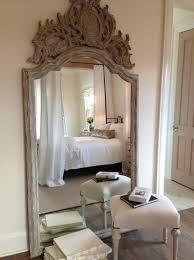 white leaning floor mirror.  Mirror Restful Bedroom With Turned Leg Stool In Front Of An Ornately Carved Arched Floor  Mirror Leaning Against The Wall Reflecting Iron Canopy Bed Dressed  Intended White Leaning Floor Mirror R
