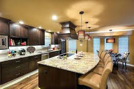 dark cabinets light countertops cabinets imposing dark wood island and matching cabinetry stand out in this