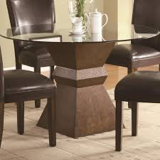 furniture glass round dining table with square dark brown wooden base connected by black leather