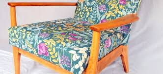 a wonderful vintage armchair from the world renowned parker knoll totally rejuvenated the beautiful wooden arms have been stripped and sanded of the old