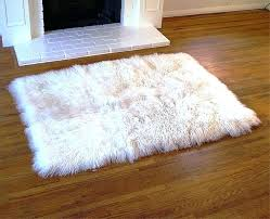 image of faux fur rug with fireplace mongolian cream color faux fur rugs