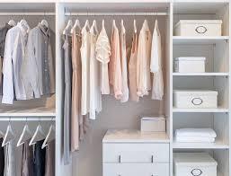 custom closets for women. Clothes Hanging On Rail In White Wardrobe. Custom Closet Organizer Closets For Women
