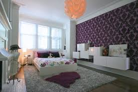 kids bedroom with damask decorating idea using wallpaper and colorful flower sheet