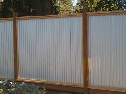image of is a corrugated metal fence er than wood