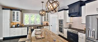 contemporary transitional kitchen has playful steel ball pendant lights black and white color scheme