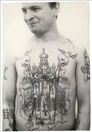 свастика тату значение в тюрьме наколка звезды на плечах