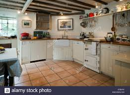 Small Fitted Kitchen Fitted Kitchen With An Unusual Small Range Cooker Stock Photo