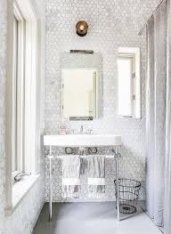 marble hex tiled bathroom walls